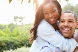 woman hugging partner outdoors