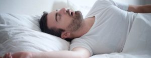 man-laying-right-side-snoring