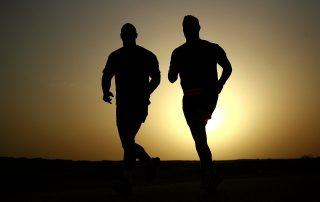 two men in silhouette jogging