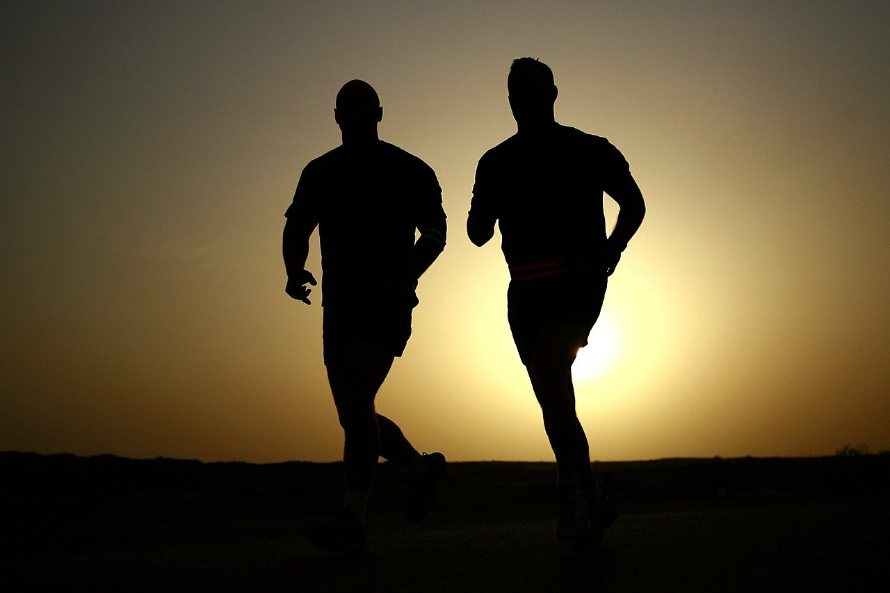 two men in silhouette jogging