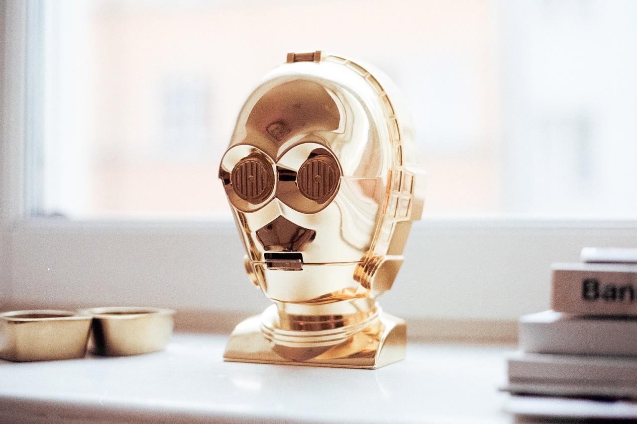 Gold head of R2D2 sitting on a desk