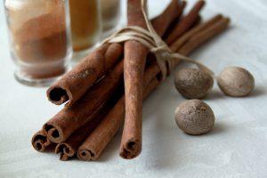 Bunch of cinnamon and three nutmegs