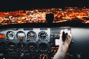 airline pilot landing plane at night