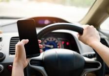 driver texting at the wheel
