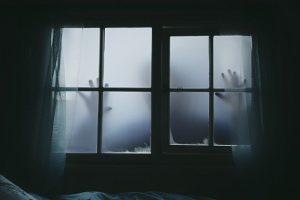 mysterious figure looking in window